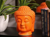 modern-buddha-statue-for-sale-online-bright-orange-ceramic-buddhist-sculpture-glossy-finish-creative-decor-ideas-for-spiritual-contemporary-home