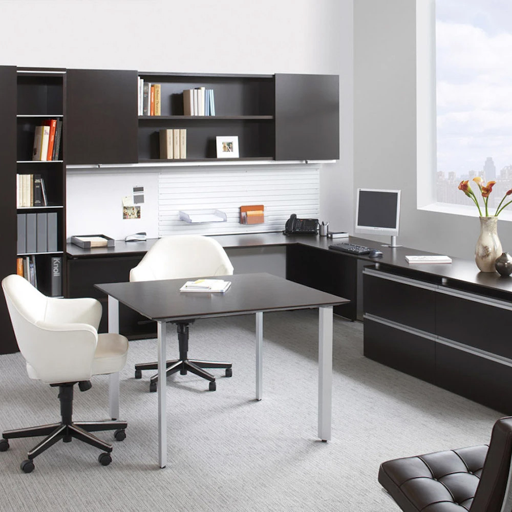 saarinen-excutive-arm-chairs-white-leather-swivel-base-in-office-knoll_1024x1024