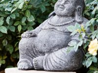 smiling-buddha-statue-volcanic-ash-cement-outdoor-garden-feng-shui-ideas-and-inspiration