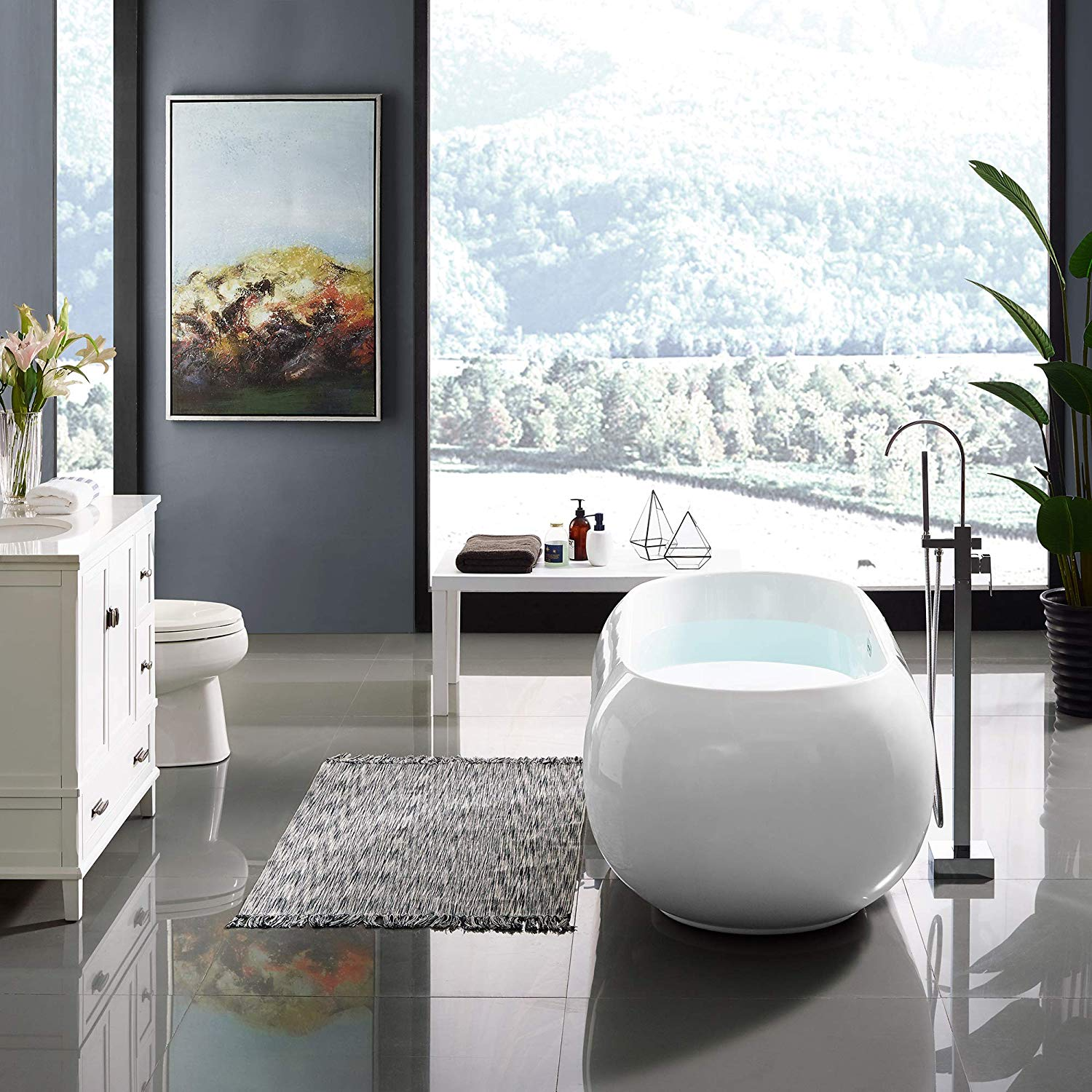 unique-free-standing-bathtub-oval-rounded-edges-fixture-for-modern-bathroom-ideas