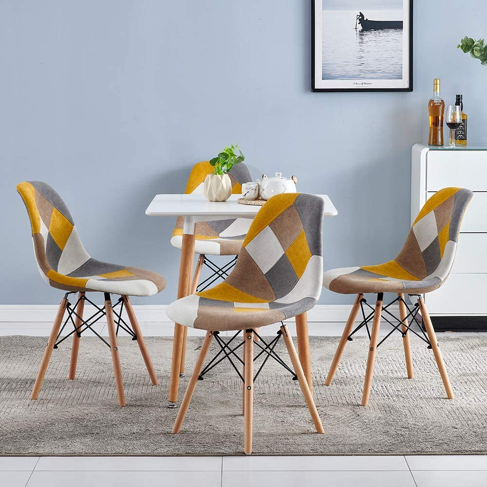 unique-patterned-upholstered-dining-chairs-eames-eiffel-base-patchwork-fabric-yellow-grey-white-brown-wood-dowel-legs-with-metal-supports