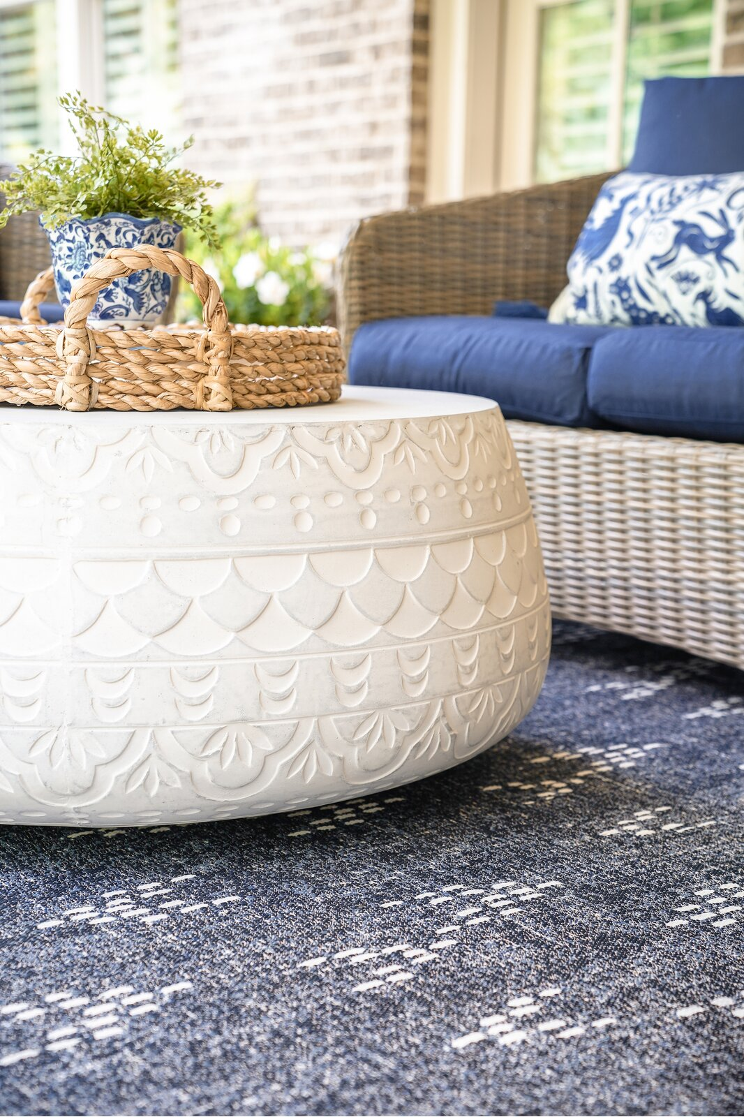 white-outdoor-coffee-table-patterned-concrete-textural-whitewashed-finish-hollow-interior-handcrafted-indoor-outdoor-furniture