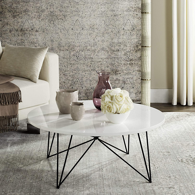 white-round-coffee-table-modern-design-inspiration-glossy-white-top-geometric-matte-black-wire-base
