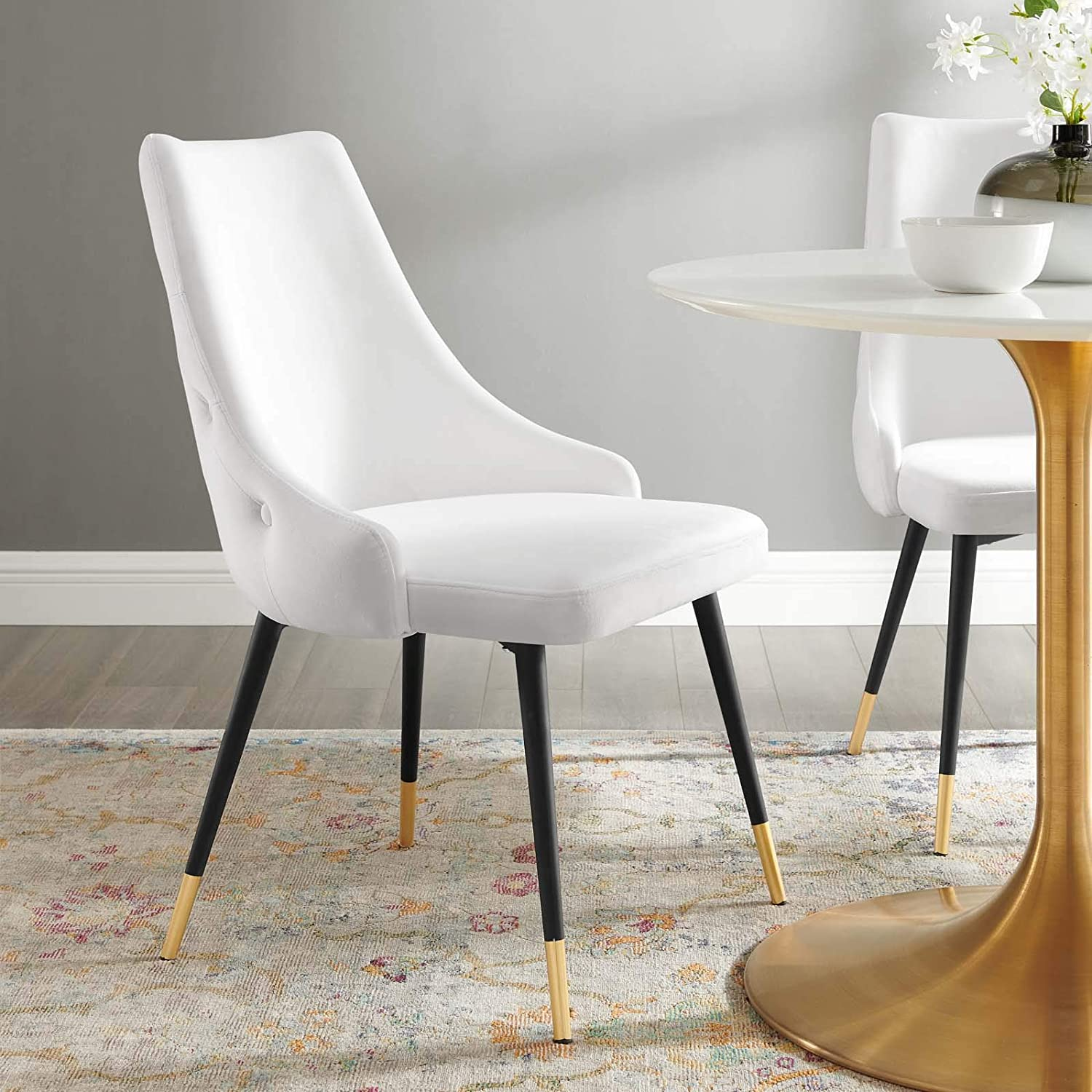 white-upholstered-dining-chair-glamorous-furniture-inspiration-button-tufted-backrest-black-mid-century-modern-legs-gold-feet