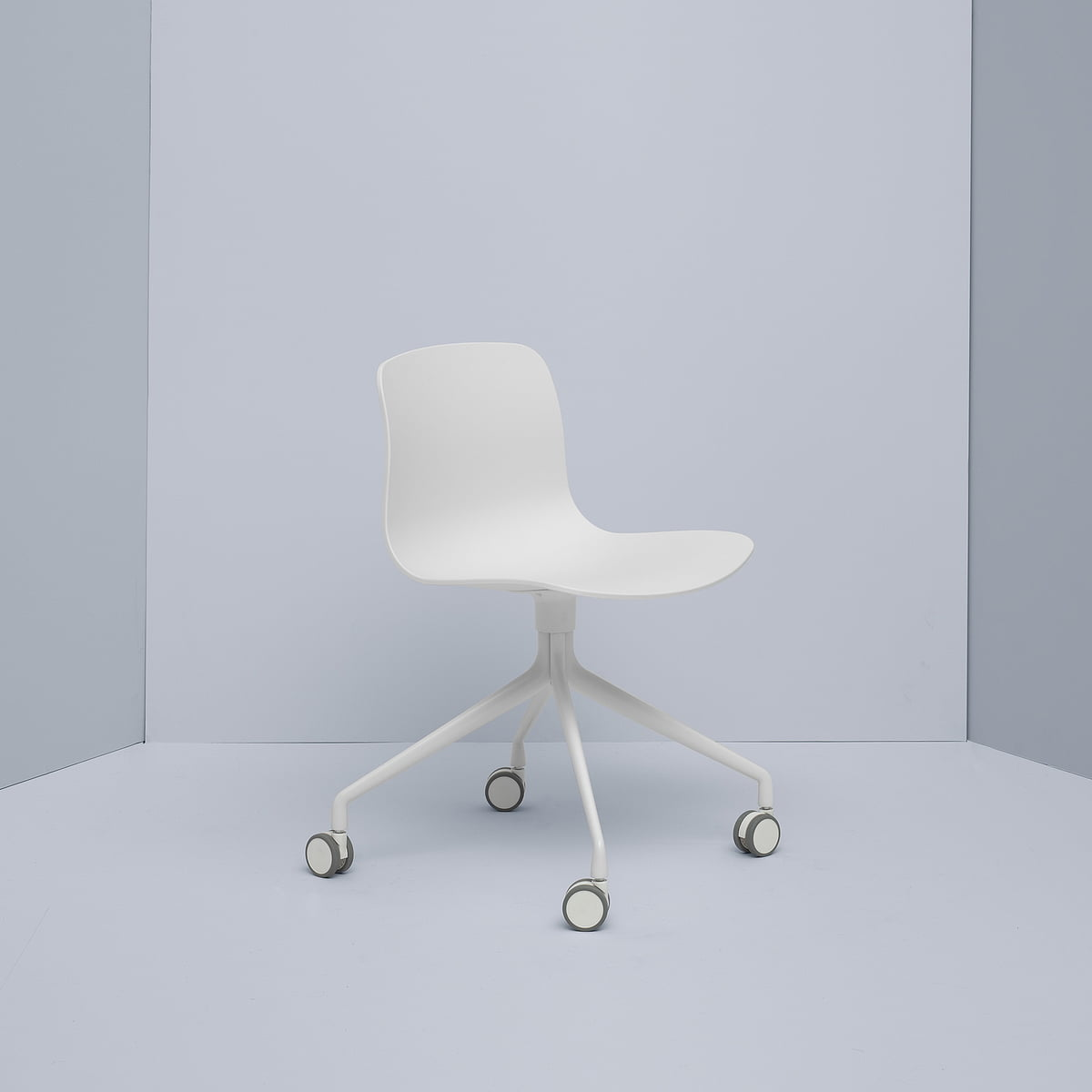 scandinavian-white-office-chair-four-wheels-white-base-and-molded-seat-minimalistic-work-from-home-furniture-for-small-spaces-1